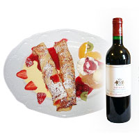 Sweet pancakes with fruits and bottle of red wine. Shop in Ukrainian Marriage Agency.
