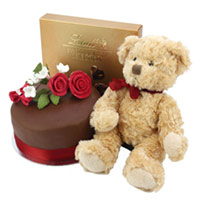 Teddy bear, cake and sweets. Shop in Ukrainian Marriage Agency.