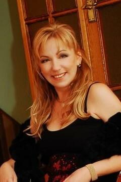 Irina from Poltava 50 years - sunny smile. My mid primary photo.