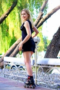 Oksana from Zaporozhye 31 years - sunny smile. My small primary photo.