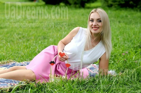Elena from Rovno 34 years - seeking soulmate. My small public photo.