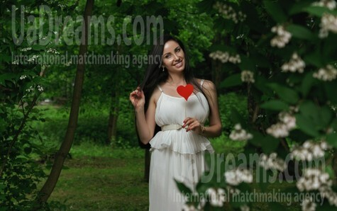 Natalia from Lviv 35 years - smiling for you. My small public photo.